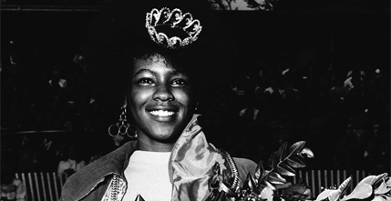 Homecoming Queen Linda Brown holding a bouquet of flowers, 1972.