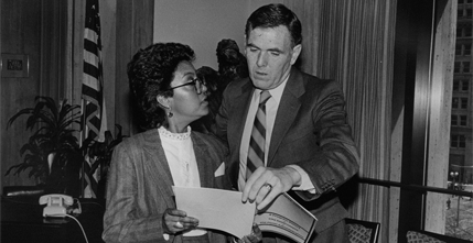 Carmen Pola and Mayor Raymond Flynn reviewing a progress report, ca. 1986.