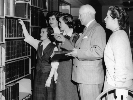 Northeastern President Carl S. Ell with students on opening day of Dodge Library, 1952.