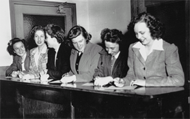 The first six Northeastern University Day College coeds register for classes, 1943.